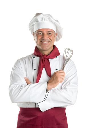 chef uniform: Happy mature professional chef holding a whisk and looking at camera isolated on white background Stock Photo