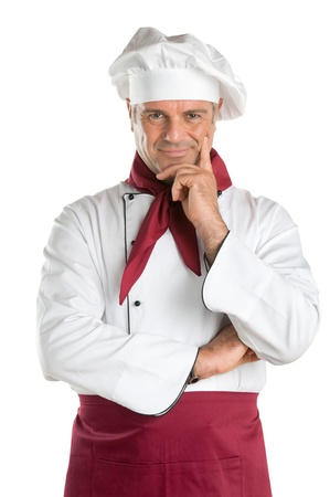 Proud and satisfied mature chef looking at camera isolated on white background photo