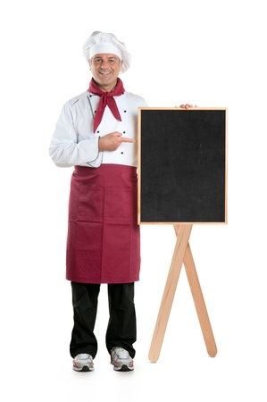 Happy mature chef showing dish of the day on a black board isolated on white background Stock Photo - 14942477