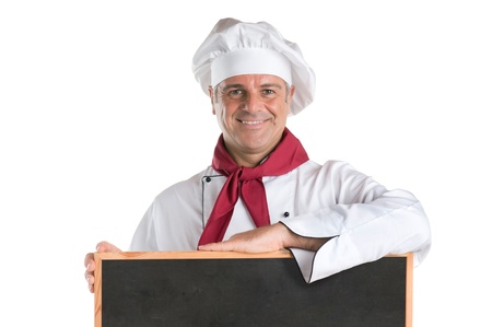 Happy mature chef showing a blank blackboard ready for your text isolated on white background photo