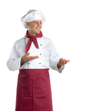 Happy mature chef showing your text or product isolated on white background photo