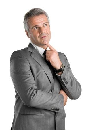 man thinking: Pensive businessman levant les yeux avec une expression pensive isol� sur fond blanc