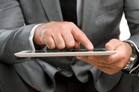 Closeup shot of businessman working on digital tablet  photo