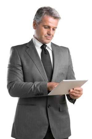 Smiling mature businessman working on digital tablet isolated on white background photo