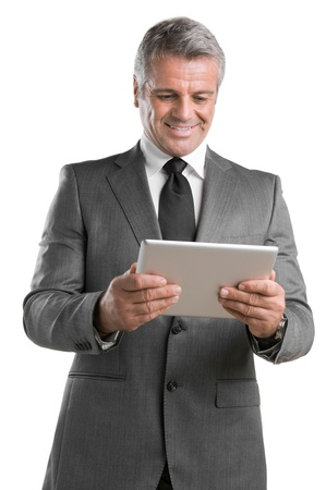 Modern mature businessman looking and working on digital tablet isolated on white background photo