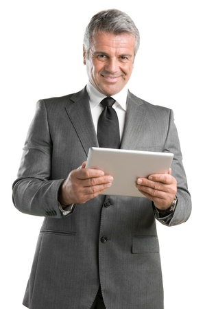 Happy mature businessman working with modern tablet isolated on white background photo