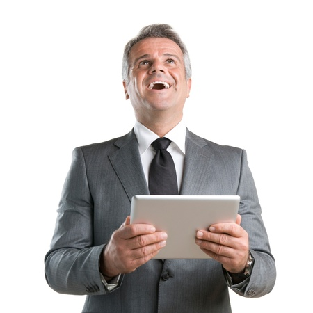 Happy joyful businessman cheering while working with his digital tablet isolated on white background photo