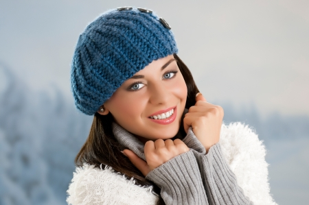 Happy smiling winter girl looking at camera outdoor in the snow Stock Photo - 15179004