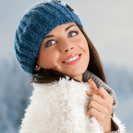 Happy beautiful young woman in warm soft clothes outdoor in a winter day Stock Photo - 15155144