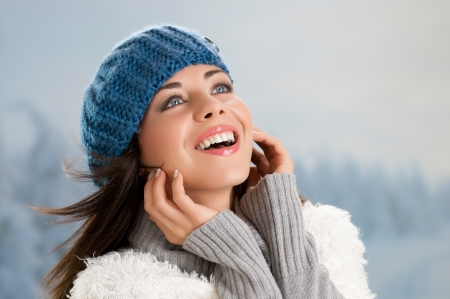 Beautiful young woman enjoying the sun in a cold winter day Stock Photo - 15155146