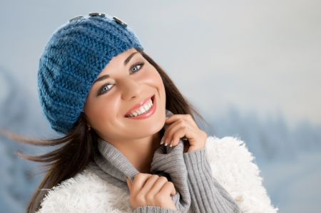 Smiling  beautiful young woman relaxing outdoor in a winter day Stock Photo - 15155142