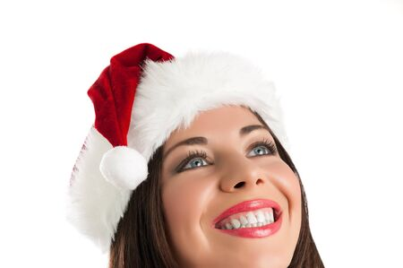 Closeup portrait of smiling girl with Christmas hat thinking isolated on white background Stock Photo - 15155134