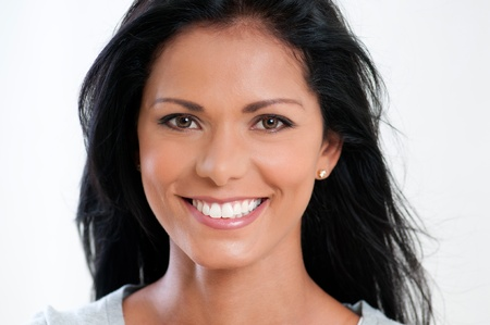 black woman face: Beautiful young woman smiling and looking at camera on white background Stock Photo