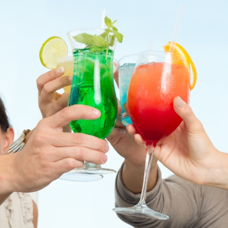 Group Of Happy Friends Celebrating Toasting With Glasses Of Cocktails  photo