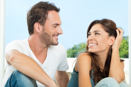 Loving Couple Having Conversation And Looking At Each Other  photo