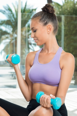 Young Woman Exercising With Dumbbells  photo