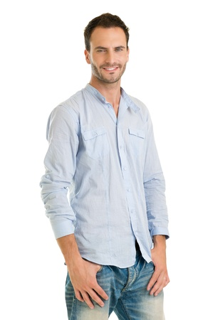 casually: Handsome Man Standing Casually Dressed Against White Background  Stock Photo