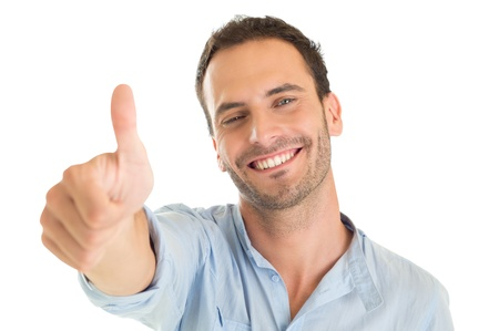 SATISFIED: Portrait Of A Happy Young Man Showing Thumb Up Sign Ispòated On White Backgorund