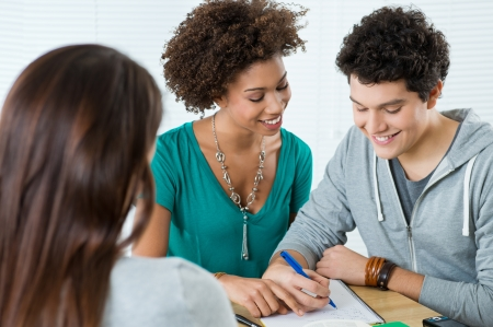 Group Of Happy Friends Studying Together in Class Stock Photo - 18325372
