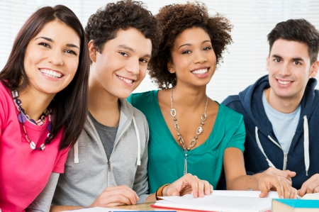 Young Students Studying Together In Classroom