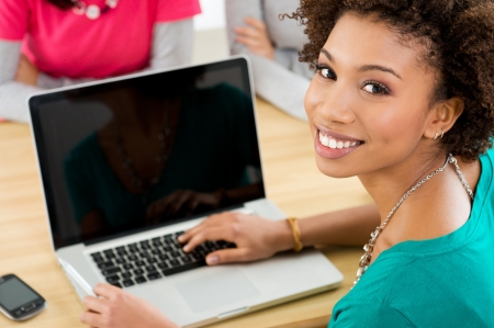 computer: Close-up Of Happy Student Working On Laptop