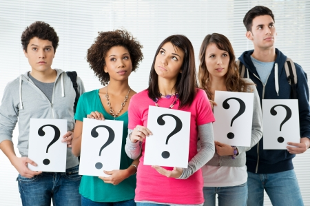 Students Holding Question Markes, What Kind of Future Could Have? Stock Photo - 18325281