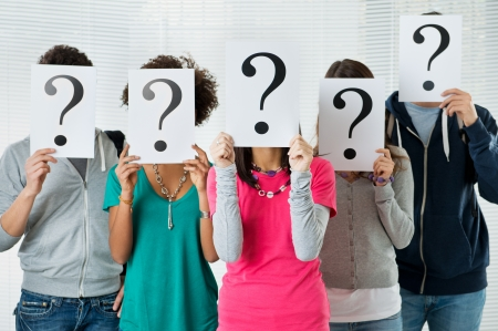 doubt: Students Hiding There Face With Question Mark Sign, uncertainty of their future concept