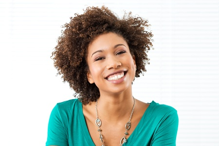 portrait of woman: Portrait Of Young African Woman Smiling  Stock Photo