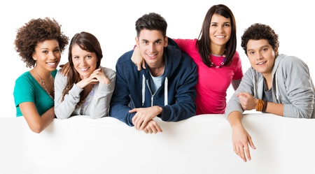 ethnic group: Happy multi ethnic group of friends showing blank billboard isolated on white background