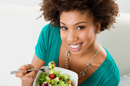 Close-up Of Beautiful African American Woman Eating Salad  photo