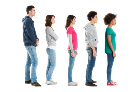 standing in line: Multi Ethnic People Standing In A Row Isolated On White Background   Stock Photo