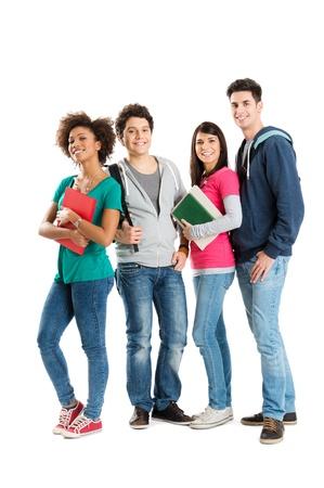 school teens: Feliz estudiantes multi�tnico aisladas sobre fondo blanco Foto de archivo