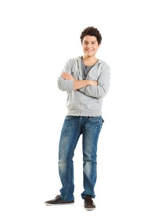 ni�o parado: Muchacho joven aislado en fondo blanco Foto de archivo