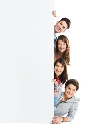 Happy Smiling Group Of Person Isolated Showing Blank Placard Board  photo