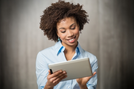 wireless technology: Portrait of a Successful Business woman Using Digital Tablet  Stock Photo