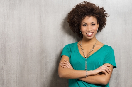 folded hands: Confident Young Woman With Arms Crossed
