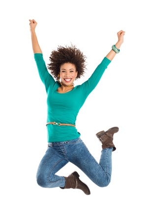 Portrait Of Gir Jumping In Joy Isolated Over White Background   photo