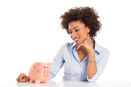 wealth management: Businesswoman Isolated On White Background Looking At Piggybank