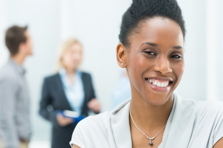 working woman: Portrait Of Young African American Businesswoman In Her Office