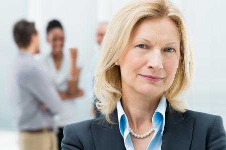 Portrait Of Happy Senior Businesswoman In Office Stock Photo - 19339105