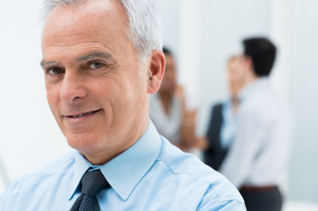 senior business: Close-up Portrait Of Happy Senior Businessman in His Office Stock Photo