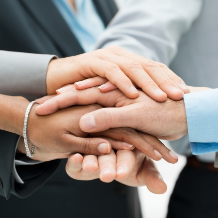 strong partnership: Closeup Of A Business Colleagues With Their Hands Stacked
