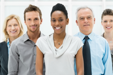 employee: Happy smiling multi ethnic business team in office