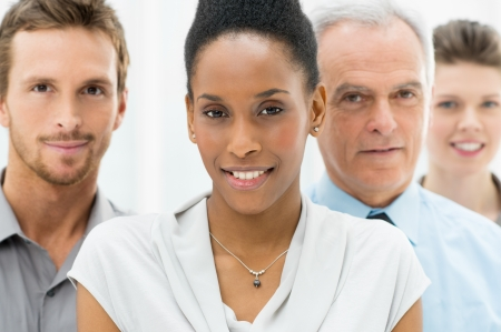 Portrait Of Young African American Businesswoman With Business Team Stock Photo - 19339113