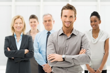 team leadership: Portrait Of Young Businessman With Business Team