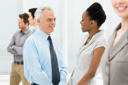 discussing: Happy Multiethnic Business People Talking During a meeting