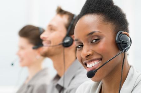 black girl: Closeup Of Happy African American Telephone Operator mit ihren Kollegen Lizenzfreie Bilder