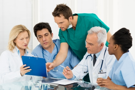 Team Of Experts Doctors Examining Medical Exams photo