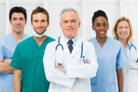 diverse: Smiling team of doctors and nurses at hospital Stock Photo