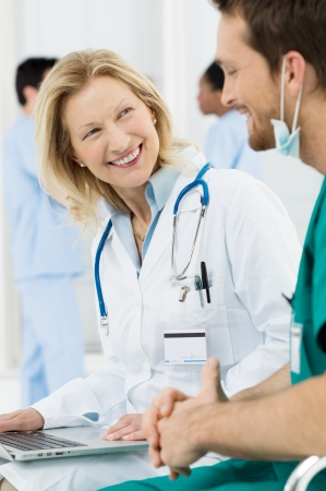 Happy Doctor In Hospital Talking With Surgeon Stock Photo - 19500074
